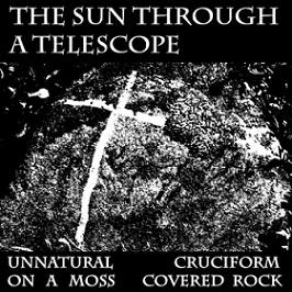 The Sun Through a Telescope - Unnatural Cruciform on a Moss Covered Rock